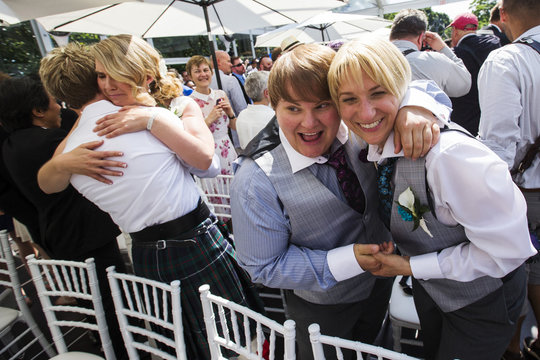 """Couples celebrate after the ceremony for """"The Celebration of Love"""", a grand wedding where over 100 LGBT couples got married, at Casa Loma in Toronto"""