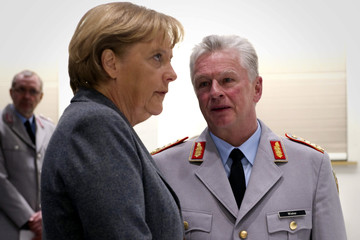 German Chancellor Merkel talks with German Bundeswehr inspector general Wieker during a visit to the German army Bundeswehr Operations Command in Geltow