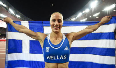 Second placed Kyriakopoulou of Greece celebrates with her national flag after the women's pole vault final at the 15th IAAF World Championships at the National Stadium in Beijing