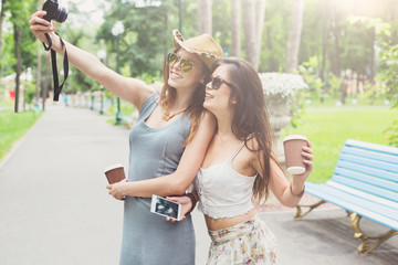 Outdoor portrait of three friends take selfie with smartphone