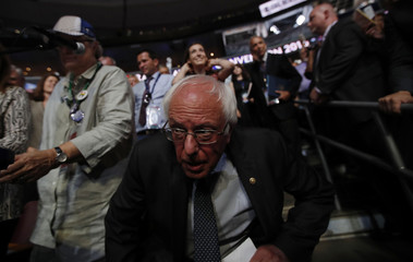 Former Democratic presidential candidate Senator Sanders arrives in the Vermont delegation to make a motion to suspend the rules and nominate Clinton during the second day at the Democratic National Convention in Philadelphia