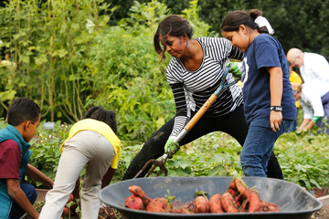 U.S. first lady Michelle Obama harvests vegetables from the White House kitchen garden with schoolchildren in Washington