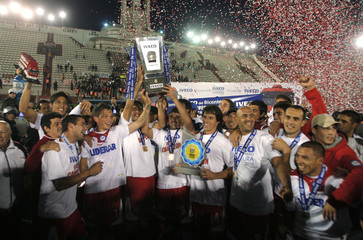 Argentinos Juniors' players celebrate after beating Huracan to clinch the title in Buenos Aires
