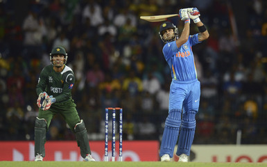 India's Virat Kohli hits a six watched by Pakistan's Kamran Akmal during the ICC World Twenty20 Super 8 cricket match at the R Premadasa Stadium in Colombo