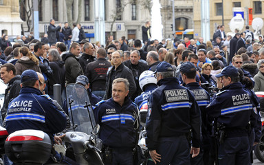 French policemen gather in front of the Police headquarter in Marseille to support their colleague seriously injured during a shooting with four men suspected of the burglary of warehouses
