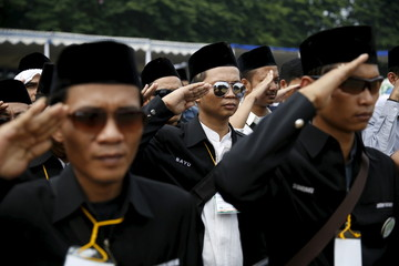 Indonesia Muslim youth salute during the ceremony of defending the country against terrorism, radicalism and drug in Jakarta