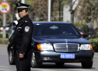 A vehicle that is believed to be carrying North Korean leader Kim Jong-il passes by a street in Beijing