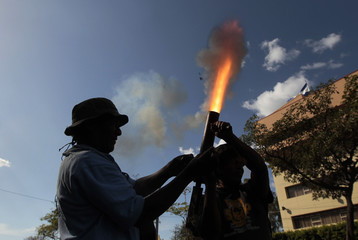 Former soldiers of the EPS fire a homemade mortar during a protest in front of National Assembly building in Managua