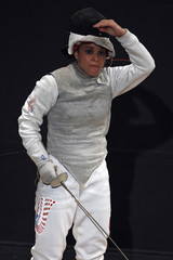 Puerto Rico's Bas reacts to a point assigned to her opponent Michel from Mexico during the women's Foil Fencing semi-finals at the Central-American Games in Mayaguez