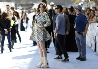Charli XCX arrives at the 2015 MTV Movie Awards in Los Angeles