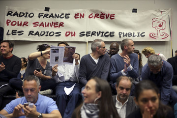 Journalists and technical staff attend an employees meeting at the Radio France headquarters, known as Maison de la Radio in Paris