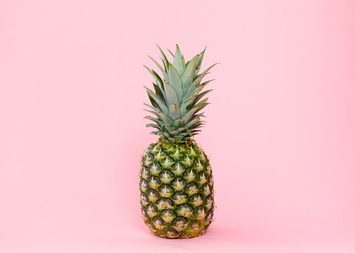 Isolated pineapple on pink background