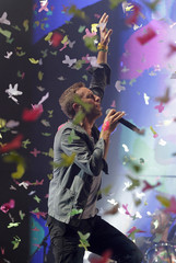 Coldplay lead singer Chris Martin performs on the Pyramid Stage on the fourth day of the Glastonbury Festival in Worthy Farm, Somerset