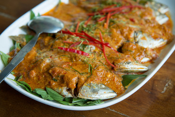 mackerel topped with chili sauce and coconut milk