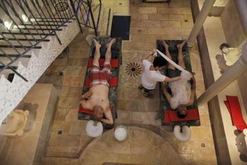 "Arab Israeli men, Abu Shamsieh and Khalifa receive a treatment at a ""hamam"", a traditional Turkish bath, in Acre"