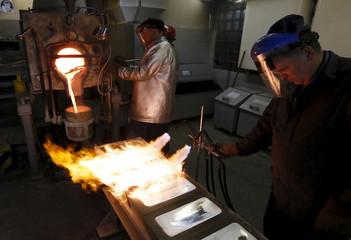 Melters cast ingots of 99.99 percent pure silver at the Krastsvetmet Krasnoyarsk non-ferrous metals plant in the Siberian city of Krasnoyarsk, Russia