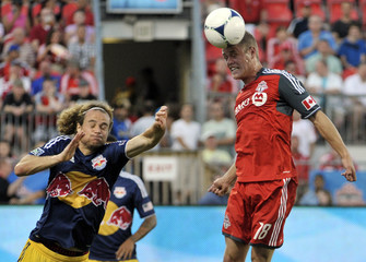 Toronto FC's Nick Soolsma heads a ball against New York Red Bulls' Stephen Keel during their MLS soccer match in Toronto