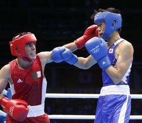 Algeria's Oudahi fights against Japan's Shimizu during their Men's Bantam (56kg) Quarterfinal boxing match during the London 2012 Olympic Games