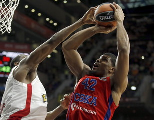 CSKA Moscow's Hines goes up for a basket over Olympiacos' Dunston during their Euroleague Final Four semi-final basketball game in Madrid