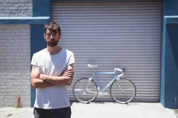 Portrait of employee standing with bicycle