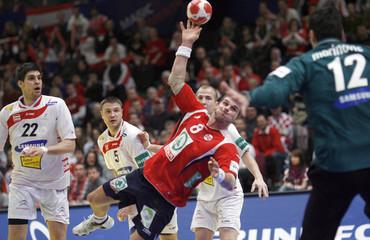 Norway's Myrhol attempts to score next to Austria's Wagesreiter,  Ziura and Marinovic during their Men's European Handball Federation Championship second round match in Vienna