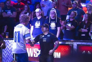 Riess shakes hands with second place finisher Farber after Riess won the World Series of Poker $10,000 buy-in no-limit Texas Hold 'Em tournament in Las Vegas, Nevada