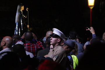 Singer Rihanna performs as a U.S. Marine stands in the audience during The Concert for Valor on the National Mall on Veterans' Day in Washington