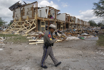 Texas Department of Public Safety Sergeant Reyes walks past site of housing complex destroyed by deadly fertilizer plant explosion in West
