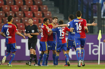 FC Basel's Stocker celebrates with team mates after scoring the first goal of the match against FC Zurich during their Swiss Super League soccer match in Zurich