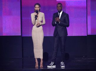 Show hosts Gigi Hadid and Jay Pharoah speak at the 2016 American Music Awards in Los Angeles