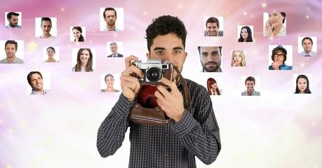 photographer holding camera against flying portraits