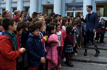 U.S. physicist Hugh Herr, recipient of the 2016 Princess of Asturias Award for Technical and Scientific Research, waves after visiting an exhibition of children's drawings dedicated to him in Aviles