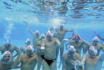 The Hungarian national water polo team gather for a photo shoot underwater after a training session in Budapest