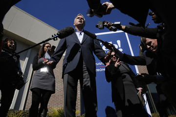 Bush talks to reporters after a town hall meeting with employees at FN America gun manufacturers in Columbia, South Carolina