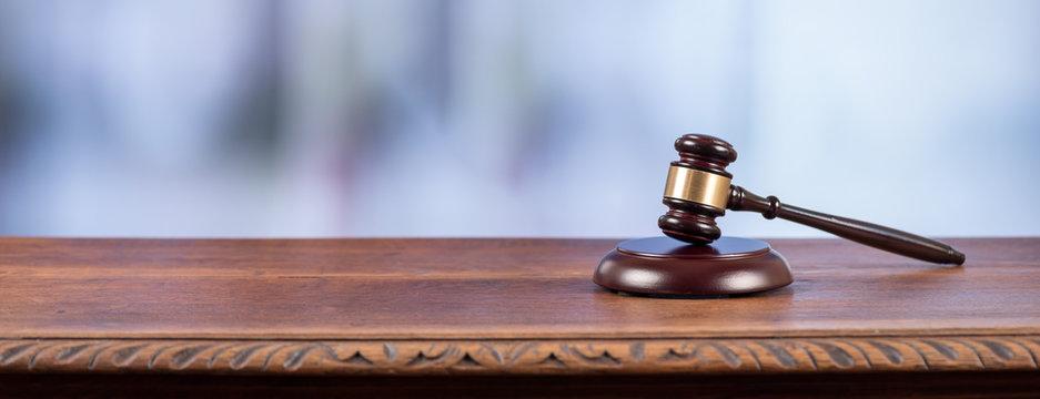 Judge hammer on an old desk