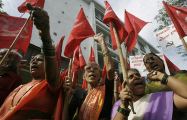 Activists from CPI-M hold flags and placards in Mumbai
