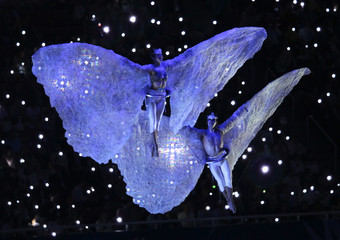 Performers wearing butterfly wings participate at the opening ceremony of the Pan American Games in Guadalajara