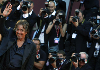 "Director and actor Pacino of U.S. poses for photographers as he arrives on ""Wilde Salome"" red carpet at 68th Venice Film Festival"