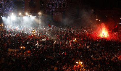 Supporters of the Islamist Ennahda movement attend a rally in Tunis