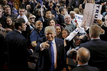 U.S. Republican presidential candidate Donald Trump, with U.S. Secret Service agents around him, gestures to the cameras while greeting supporters at a campaign rally in Worcester