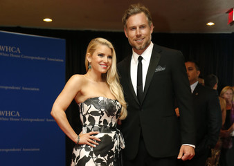 Actors Simpson and Johnson arrive on the red carpet at the annual White House Correspondents' Association Dinner in Washington