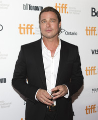"""Actor Brad Pitt arrives for the """"12 Years a Slave"""" screening at the 38th Toronto International Film Festival in Toronto"""