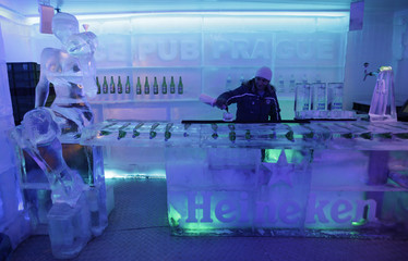 Bartender prepares drink for a customer in Ice Pub Prague in central Prague
