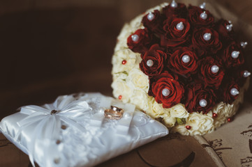 beautiful modern wedding bouquet with rings