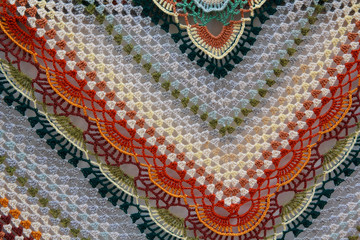Multicolored knitted woolen shawl. Backgrounds and textures