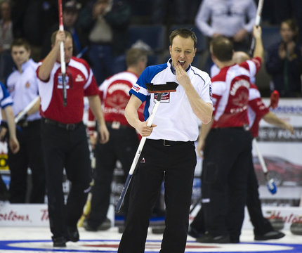 Scotland's skip Tom Brewster leaves ice after his team's loss to Canada during World Men's Curling Championships in Regina