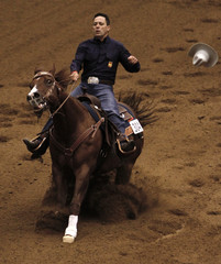 Francesc Cueto of Spain riding A Real Hillbilly competes in the team reining competition at the World Equestrian Games in Lexington