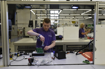 Technician assembles a drive ready for testing on the production floor of Invertek Drives in Welshpool, Wales