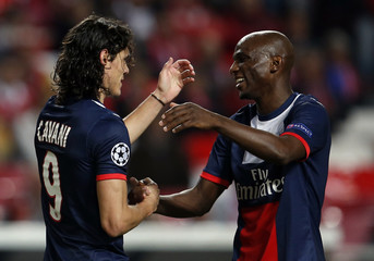 Paris St Germain's Cavani is congrtulated by his team mate Camara after scoring a goal against Benfica during their Champions League soccer match in Lisbon