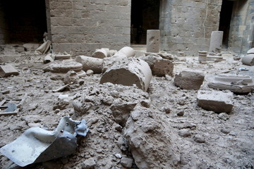 Remnants of a shell are seen amidst damaged pillars in the Sahat al-Mumathileen Bosra's ancient citadel, after what activists said was an airstrike by forces loyal to President Assad in the historic Syrian southern town of Bosra al-Sham, Deraa